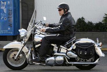 arnold schwarzenegger still riding a harley at cyril huze post